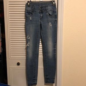 Distressed size 4 mid rise skinny jeans
